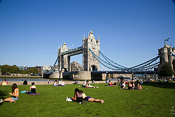 © Licensed to London News Pictures. 14/09/2020. London, UK. Fewer people enjoy the warm and sunny weather in Potters Field Park during lunchtime as the mini heatwave continues in the capital. Potters Field Park and nearby Moor London would normally be very busy with tourists and office workers during sunny weather. The government has announced that gatherings of more than six people are banned from today as the numbers of COVID19 cases have started to increase. Photo credit: Dinendra Haria/LNP