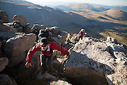 Alex Lee and Danielle Perrot navigate a boulder field on the SE Ridge of Mount Bierstadt in the Mount Evans Wilderness, Rocky Mountains Front Range, Colorado.