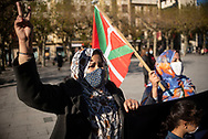 A saharawi woman makes the sign of victory as another woman holds the Basque flag during a demonstration to demand the end of Morocco's occupation in Western Sahara, in support of the Polisario Front and to demand solutions from the Spanish government. Irun (Basque Country). November 21, 2020. The Polisario Front declared a state of war in Western Sahara as they say Morocco broke the ceasefire agreement in force since 1991, after Morocco sent the Army to Guerguerat, on the border between western Sahara and Mauritania to dismantle the blockade of some Saharan protesters. (Gari Garaialde / Bostok Photo)
