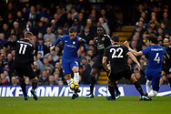 Eden Hazard of Chelsea (c) takes on Leicester City players Marc Albrighton (L), Wilfred Ndidi (1R) & Matty James of Leicester City (2R). Premier League match, Chelsea v Leicester City at Stamford Bridge in London on Saturday 13th January 2018.<br /> pic by Steffan Bowen, Andrew Orchard sports photography.