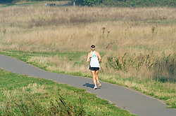 ©Licensed to London News Pictures 15/09/2020  <br /> Sidcup, UK. A lady on a morning run. A sunny morning at Footscray Meadows in Sidcup, South East London. Today is set to be another hot day of September sun. credit:Grant Falvey/LNP