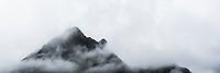 Mountain peak hidden in clouds, Lofoten Islands, Norway