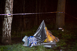 ©Licensed to London News Pictures 15/03/2020<br /> Woolwich, UK. Items covered in plastic on scene. Detectives are investigating following the fatal stabbing of a man in Woolwich, London. Part of Woolwich Common has a police cordon in place with police on guard.  Photo credit: Grant Falvey/LNP