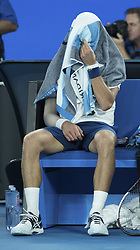 MELBOURNE, Jan. 22, 2018  Novak Djokovic of Serbia covers his head with a towel during the men's singles fourth round match against Chung Hyeon of South Korea at Australian Open 2018 in Melbourne, Australia, Jan. 22, 2018. Djokovic lost by 0-3. (Credit Image: © Zhu Hongye/Xinhua via ZUMA Wire)