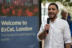 London, UK. 14th September, 2021. Sayed Ahmed Alwadaei, director of the Bahrain Institute for Rights and Democracy (BIRD), addresses Stop The Arms Fair activists protesting outside ExCeL London on the first day of the DSEI 2021 arms fair. Activists from a range of different groups have been protesting outside the venue for one of the world's largest arms fairs for over a week.