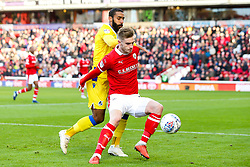 Liam Lindsay of Barnsley takes on Stefan Payne of Bristol Rovers - Mandatory by-line: Robbie Stephenson/JMP - 27/10/2018 - FOOTBALL - Oakwell Stadium - Barnsley, England - Barnsley v Bristol Rovers - Sky Bet League One