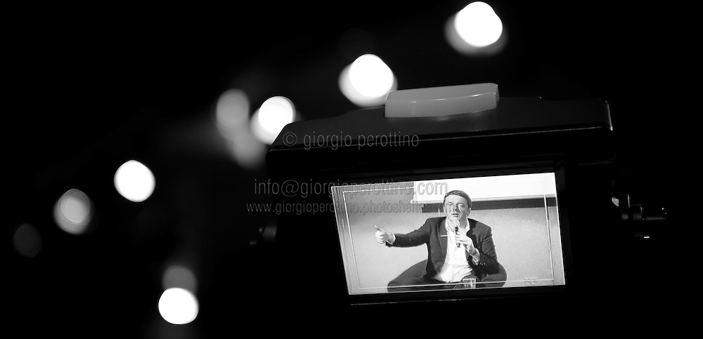 Matteo Renzi is seen on a TV camera display during his political campaign convention for the Partito Democratico's primary elections -Italian left wing Party - in Turin, December 6, 2013.