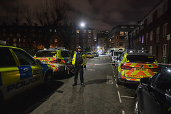 © Licensed to London News Pictures. 02/01/2021. London, UK. A polcie officer maintains a cordon close to the incident staging area. Police attended a call 14:12 GMT on Saturday 2nd January to a disturbance at Great Dover Street, SE1. Due to threats made to officers, a multi-agency response was coordinated. Photo credit: Peter Manning/LNP