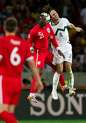 Emile Heskey of England vs Marko Suler of Slovenia during the 2010 FIFA World Cup South Africa Group C Third Round match between Slovenia and England on June 23, 2010 at Nelson Mandela Bay Stadium, Port Elizabeth, South Africa.  (Photo by Vid Ponikvar / Sportida)