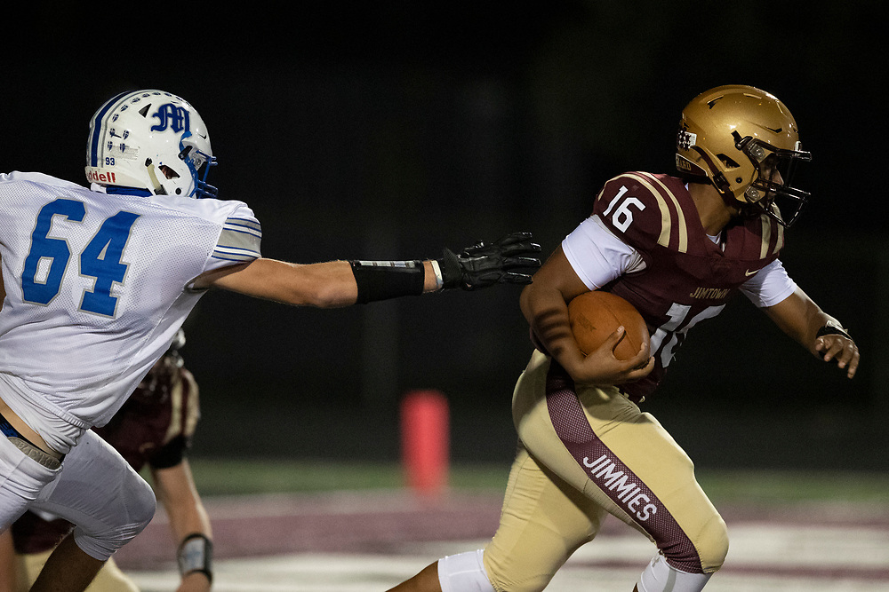 Jimtown's Tysen House escapes the safety as Marian defender pursues during the Marian-Jimtown high school football game on Friday, November 06, 2020, at Knepp Field in Elkhart, Indiana.
