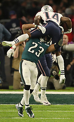 February 4, 2018 - Minneapolis, MN, USA - New England Patriots wide receiver Brandin Cooks (14) tries to jump over Philadelphia Eagles free safety Rodney McLeod (23) after making a catch in the second quarter on Sunday, February 4, 2018 at Super Bowl LII at U.S. Bank Stadium in Minneapolis, Minn. (Credit Image: © Jeff Wheeler/TNS via ZUMA Wire)
