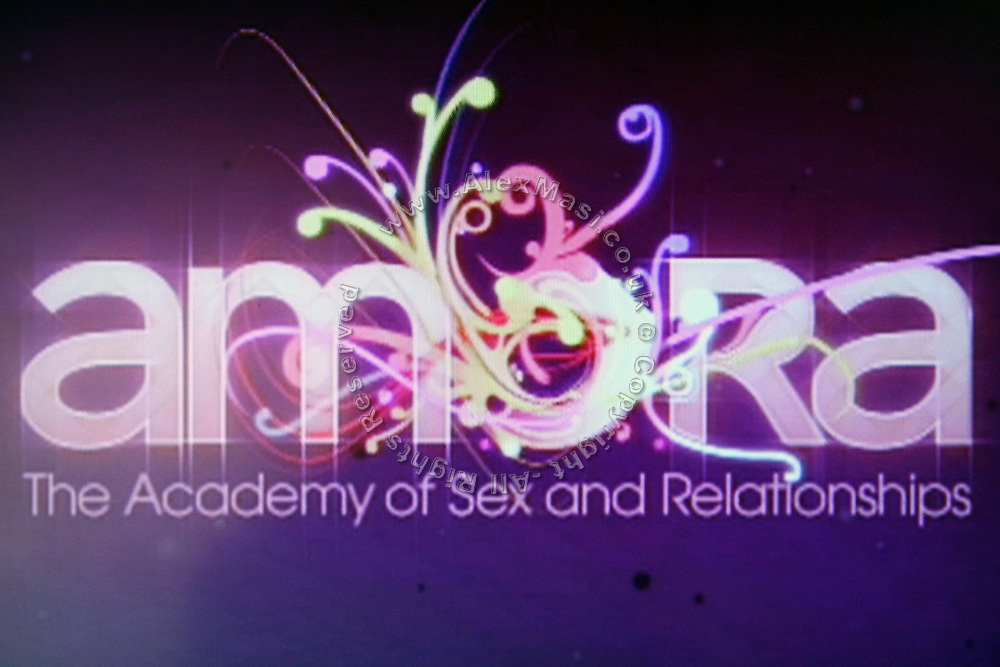 The symbol of Amora, the Academy of Sex and Relationships, is played on a TV screen at the entrance, on Tuesday, April 17, 2007, in London, UK. The world's first visitor attraction dedicated to love, sex and relationships opens its door officially tomorrow (18th of April 2007) in Piccadilly. The permanent interactive attraction, Amora, expects to draw over half a million, 18+ visitors in the first year and fuses entertainment, excitement and education in a unique powerful sensory experience. With seven zones covering every aspect of relationships from first filtrations and dating to fantasy and fetish. Visitors can explore the science of attraction - what they find attractive and why, learn how to enhance their skills and even create what their perfect partner might look like. Male and female models help demystify erogenous zones, G-spot and prostate, while insights and technique tips are offered on various topics. Sexual awareness and well-being are also covered thoroughly. **Italy Out**..