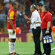 Galatasaray's coach Fatih TERIM (C) and Felipe MELO (L) during their Turkish Super League soccer match Galatasaray between Samsunspor at the Turk Telekom Arena at Seyrantepe in Istanbul Turkey on Sunday, 18 September 2011. Photo by TURKPIX