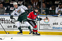 KELOWNA, BC - SEPTEMBER 28:  Pavel Novak #11 of the Kelowna Rockets skates from behind the net as Max Patterson #12 of the Everett Silvertips recovers his footing after a check  at Prospera Place on September 28, 2019 in Kelowna, Canada. (Photo by Marissa Baecker/Shoot the Breeze)