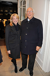 SIR EVELYN & LADY DE ROTHSCHILD at a party to celebrate the switching on of the Christmas Lights at the Stella McCartney store, Bruton Street, London on 29th November 2011.