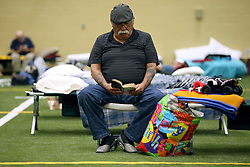Juan Garza from Corpus Christi, Texas, USA, reads a book as he stays at the FEMA Dome after Hurricane Harvey displaced his family, on Wednesday, August 30, 2017, at Tulsa-Midway High School in Corpus Christi. Photo by Gabe Hernandez/Corpus Christi Caller-Times/TNS/ABACAPRESS.COM