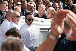 © Licensed to London News Pictures . Salford , UK . File picture of JOHN KINSELLA (with cropped grey hair and glasses, behind coffin) carrying Paul Massey's coffin at Paul Massey's funeral , in Salford , on 28th May 2015. Police have arrested several men in connection with the murders of both Kinsella and Massey. Photo credit : Joel Goodman/LNP