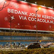 NLD/Amsterdam/20161222 - Kerstreclame Coca Cola aan de buitenzijde van de verbouwing van AH Wibaustraat Amsterdam