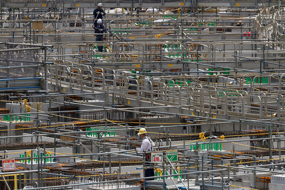 Workmen at the construction site of the 2020 Olympic Stadium in Gaiemmae, Tokyo, Japan. Friday July 7th 2017