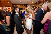 MARK JACOBS; ELLE MACPHERSON, Louis Vuitton openingof New Bond Street Maison. London. 25 May 2010. -DO NOT ARCHIVE-© Copyright Photograph by Dafydd Jones. 248 Clapham Rd. London SW9 0PZ. Tel 0207 820 0771. www.dafjones.com.