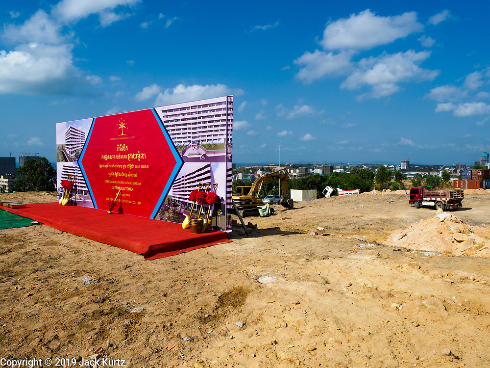 """14 FEBRUARY 2019 - SIHANOUKVILLE, CAMBODIA:  The site of the groundbreaking for the Trimulia Tower, a joint Chinese-Malaysian mixed use development in Sihanoukville. The tower will be a few kilometers from central Sihanoukville. The developers said skyrocketting land prices in Sihanoukville forced them to select land further from downtown. There are about 80 Chinese casinos and resort hotels open in Sihanoukville and dozens more under construction. The casinos are changing the city, once a sleepy port on Southeast Asia's """"backpacker trail"""" into a booming city. The change is coming with a cost though. Many Cambodian residents of Sihanoukville  have lost their homes to make way for the casinos and the jobs are going to Chinese workers, brought in to build casinos and work in the casinos.      PHOTO BY JACK KURTZ"""