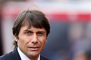Antonio Conte , the Chelsea manager looks on from the dugout. Premier league match, Stoke City v Chelsea at the Bet365 Stadium in Stoke on Trent, Staffs on Saturday 18th March 2017.<br /> pic by Andrew Orchard, Andrew Orchard sports photography.