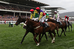 Jockey Robbie Power (left) celebrates after his winning ride on Sizing John in the Timico Cheltenham Gold Cup Chase during Gold Cup Day of the 2017 Cheltenham Festival at Cheltenham Racecourse.