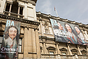 Exterior of the Royal Academy in Piccadilly where the exhibition entitled Charles 1, King and Collector is exhibited, on 6th April 2018, in London, England. This is a new cast of the original that was first exhibited outside the RA in 1904 and is an allegory of the human need for new challenges, of our instinct to always be scanning the horizon and the future. King Charles I amassed one of the most extraordinary art collections of his age, acquiring works by some of the finest artists of the past – Titian, Mantegna, Holbein, Dürer – and commissioning leading contemporary artists such as Van Dyck and Rubens. Following the his execution in 1649, the kings collection was sold off and scattered across Europe. Many works were retrieved during the Restoration, others now form the core of museums such as the Louvre and the Prado. This show reunites the greatest masterpieces of this magnificent collection for the first time.