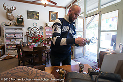"Alan Stulberg of Revival Cycles (Austin) stops to check out an antique store where he found an amazing ""Billy"" jacket for me during Stage 14 - (284 miles) of the Motorcycle Cannonball Cross-Country Endurance Run, which on this day ran from Meridian to Lewiston, Idaho, USA. Friday, September 19, 2014.  Photography ©2014 Michael Lichter."