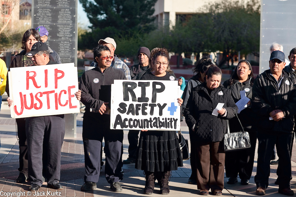 """05 DECEMBER 2009 -- PHOENIX, AZ: Protestors in front of the Maricopa County Board of Supervisors meeting in Phoenix, AZ, Monday. About 200 people from several Phoenix area civil rights groups held a mock """"funeral"""" for civil rights in Phoenix Monday to protest actions taken by the Maricopa County Board of Supervisors recent decisions that limit protestors' ability to speak out against Sheriff Joe Arpiao during Board of Supervisors meetings. The protestors have been attending meetings to protest the Sheriff's series of anti-immigrant sweeps in Latino neighborhoods of Phoenix. Photo by Jack Kurtz / ZUMA Press"""