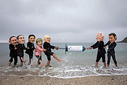 Joe Biden and Emmanuel Macron face off against Boris Johnson and the other G7 leaders in a tussle over a giant syringe, with campaigners for The People's Vaccine Alliance pose as G7 leaders, fighting over a COVID-19 vaccine on the 11th of June 2021 near Falmouth, Cornwall, United Kingdom.US President Joe Biden is the only G7 leader to back a waiver on intellectual property for vaccines that would allow mass production to vaccinate the world. A key issue for the G7 leaders to make an agreement on this weekend at the 47th G7 summit.