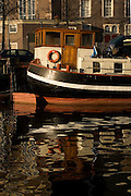 Reflection of Barge on canal, Amsterdam..walshy@blather.net.+353872207023