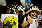 Several thousand people gather outside the Prime Minister's house and in front of the Diet building in Tokyo to protest against nuclear power. Nagatacho Tokyo, Japan. Friday August 10th 2012. Protests have been held every Friday from 6pm to 8pm since March 2012 and participants have been growing in number as Prime Minister Noda carries out his policies of restarting Japan's nuclear reactors. All japan's nuclear reactors were shut down for safety checks after the Fukushima accident on March 11th 2011