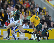 """Jaque Fourie makes a strong run for South Africa late in the match during action from the Tri-Nations Rugby Test Match played between Australia and South Africa at Suncorp Stadium (Brisbane, Australia) on Saturday 24th July 2010<br /> <br /> Conditions of Use : This image is intended for Editorial use only (news or commentary, print or electronic) - Required Images Credit """"Steven Hight - Auraimages/Photosport"""