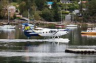 Harbour Air Seaplane (DHC-3 Turbine Single Otter) taxiing out of Ganges Harbour on Salt Spring Island, British Columbia, Canada.