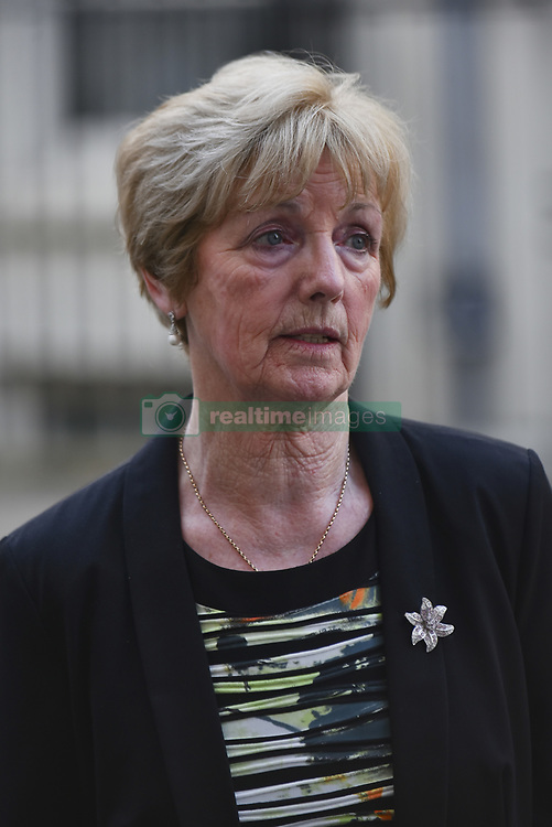April 18, 2018 - London, England, United Kingdom - Marie McCourt, mother of Helen McCourt, bring a box to Downing Street with a petition to Introduce Helen's Law where hiding a body becomes a criminal offence, London on April 18, 2018. an Simms is serving a life sentence for the murder of Helen McCourt, aged 22, on 9 February 1988, in Billinge, Lancs. Simms has always refused to reveal the whereabouts of Helen's body. The case made legal history as only the third ever UK murder trial without a body and was one of the first in the UK to use DNA fingerprinting. (Credit Image: © Alberto Pezzali/NurPhoto via ZUMA Press)