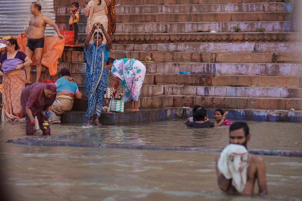 Hindu people bathing at Ganges river in Varanasi in India.