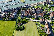 Nederland, Noord-Holland, Gemeente Waterland, 13-06-2017; het voormalig eiland Marken, nu met een dam verbonden met Waterland. Het omliggende water is het Markermeer (IJsselmeer, Zuiderzee). Havenbuurt en jachthaven.<br /> The former island of Marken, now connected with a causeway (dam) to the mainland. <br /> luchtfoto (toeslag op standaard tarieven);<br /> aerial photo (additional fee required);<br /> copyright foto/photo Siebe Swart