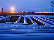 Lines from production pads and flare near Gathering Center 1, BP's side of the Prudhoe Bay Oil Field, North Slope, Alaska.