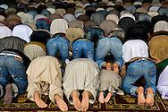 Bowing towards Mecca on a Friday at Jamia Masjid.