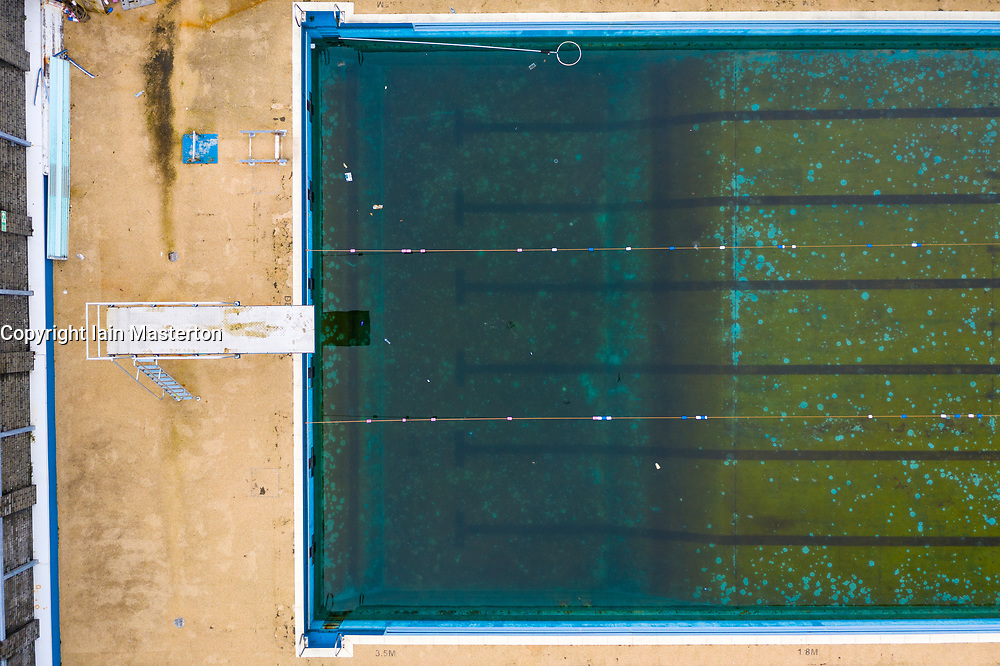 Aerial drone view of dirty stagnant water in Gourock open air swimming pool during covid-19 lockdown, Inverclyde, Scotland, UK