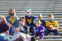 Oct 31, 2020; Morgantown, West Virginia, USA; West Virginia Mountaineers fans sit in the stands before the game against the Kansas State Wildcats at Mountaineer Field at Milan Puskar Stadium. Mandatory Credit: Ben Queen-USA TODAY Sports