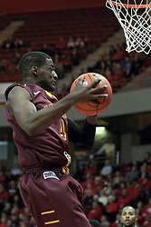 11 January 2014:  Devon Turk gets a defensive rebound during an NCAA  mens basketball game between the Ramblers of Loyola University and the Illinois State Redbirds  in Redbird Arena, Normal IL.  Redbirds win 59-50