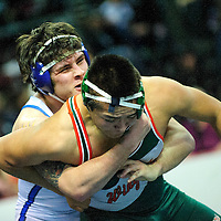 022214  Adron Gardner/Independent<br /> <br /> St. Michaels Horseman Luke Sanchez gets ahold of Wingate Bear Donavan Clyde during the state wrestling championship finals at the Santa Ana Star Center in Rio Rancho Saturday.  Sanchez beat Clyde for the 3A 182-pound title by technical fall.