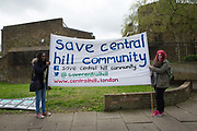 Housing campaigners during the Reclaim Brixton Demonstration, an anti gentrification demonstration on 25th April 2015 in South London, United Kingdom. Cressingham Gardens is a council garden estate, located on the southern edge of Brockwell Park. It comprises of 306 dwellings and built to the design of Lambeth Borough Council architect Edward Hollamby in the early 1970s. In 2012, Lambeth Council proposed regeneration of the estate, a decision highly opposed by many residents. Since the announcement, the highly motivated campaign group Save Cressingham Gardens has been active.