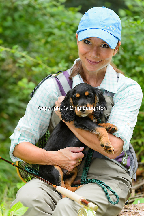 English Cocker Spaniel Puppy and fly fisher woman stock photo image