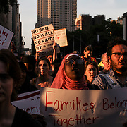 NEW YORK, NY - JUNE 26: Protesters march down Broadway after a rally was held outside of Manhattan Federal Court. They came out to protest the Supreme Court's decision to uphold President Trump's travel ban during a rally and march from Foley Square to Battery Park on June 26, 2018 in New York City. (Photo by Byron Smith/Getty Images)
