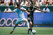 Manchester City's David Silva battles Los Angeles Galaxy's Sean Franklin for the ball during the first half of an friendly soccer match, Sunday, July 24, 2011, in Carson, Calif. (AP Photo/Bret Hartman)