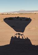 Shadow of hot air balloon ready to start on desert, Atacama Desert, Chile