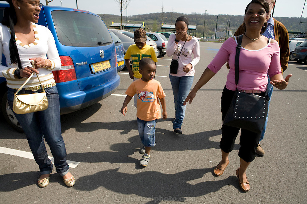 Lopes-Furtado family from Cabo Verde living in Luxembourg shopping for one week's worth of food at an Auchan super market across the border in France near their home. Maria Natercia Lopes-Furtado, and  and their four children: Darlene, Melody, Teddy, and Lionel. MODEL RELEASED. The image is part of a collection of images and documentation for Hungry Planet 2, a continuation of work done after publication of the book project Hungry Planet: What the World Eats.
